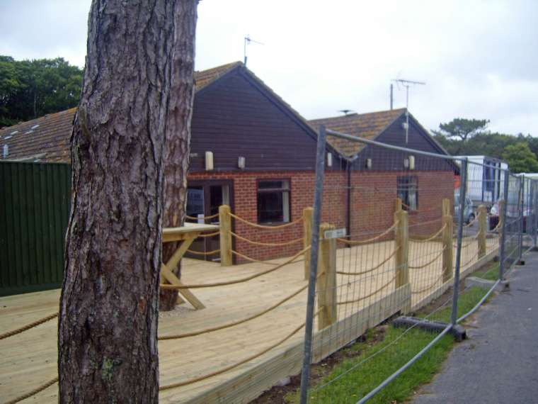 Decking Man o' War Caravan Park Durdle Door - Emerald Painters Portfolio