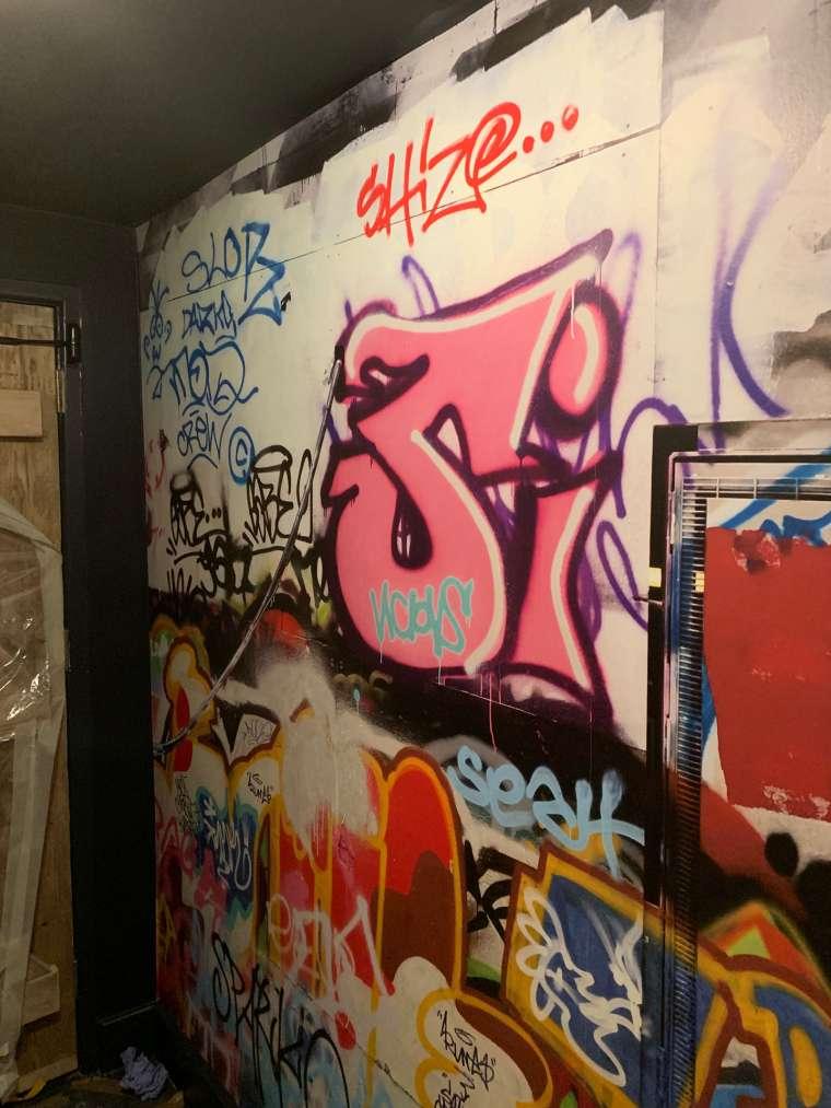 Graffiti wallpaper hanging in a club in Bournemouth - Emerald Painters Portfolio