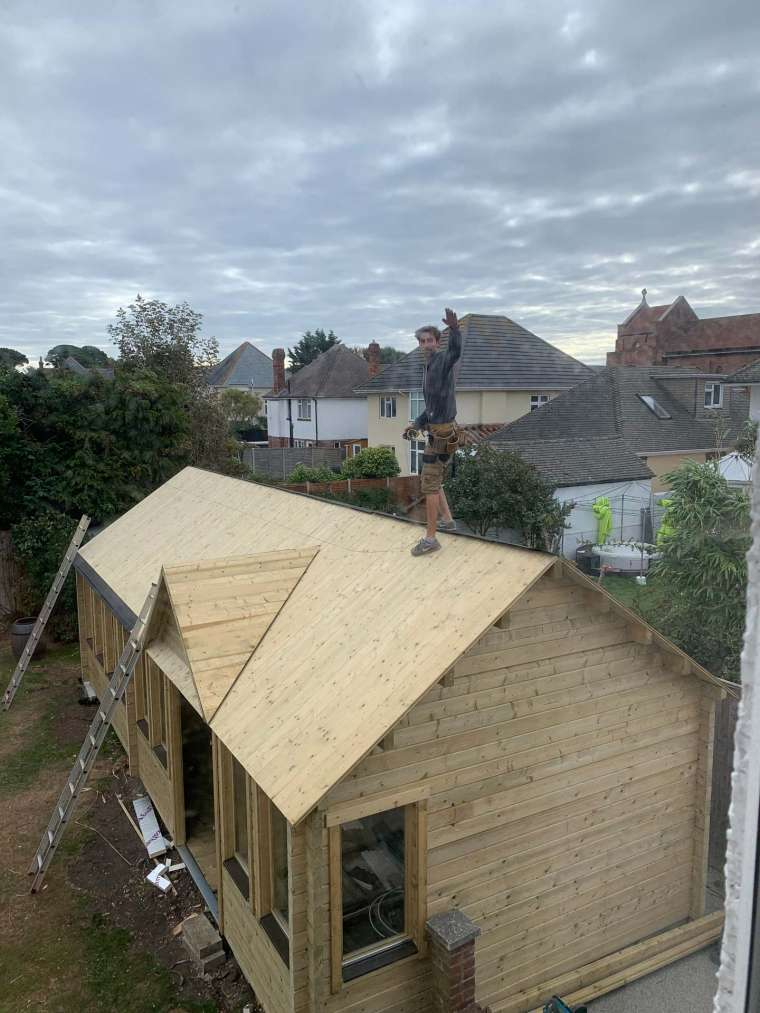 Emerald Office Headquarters Log Cabin Building Bournemouth - Working on the Roof