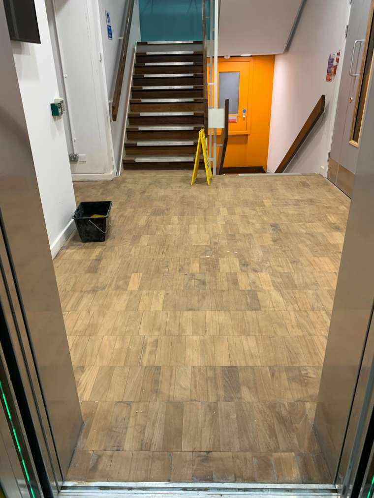 Southampton University - Restoration of Parquet Flooring with Intumescent Varnish - Before - Emerald Painters Portfolio
