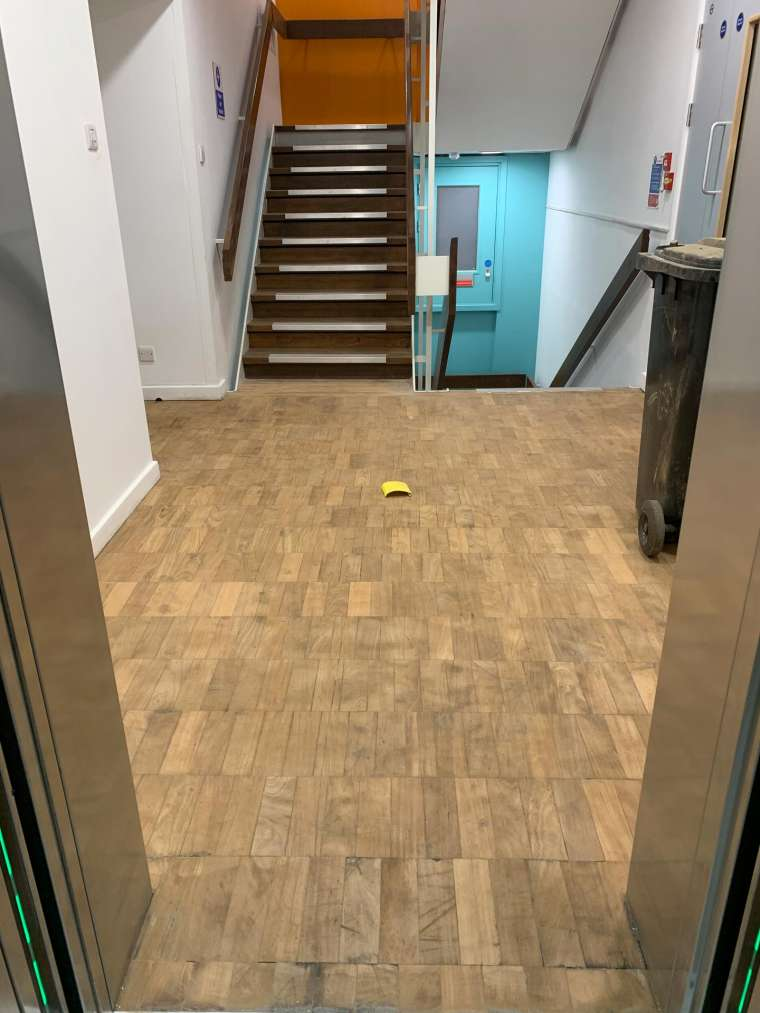 Southampton University - Restoration of Parquet Flooring with Intumescent Varnish - Before - Emerald Painters Portfolio
