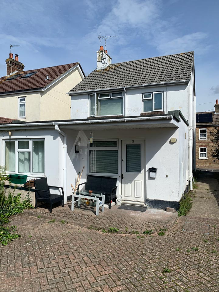 Exterior Painting to Back of Home in Poole - Before Photo by Emerald Painters