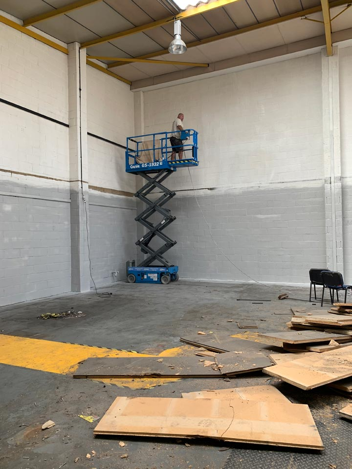 Paint Spraying the Interior Walls to an Industrial Warehouse Unit in Hamworthy - Before Photo by Emerald Painters