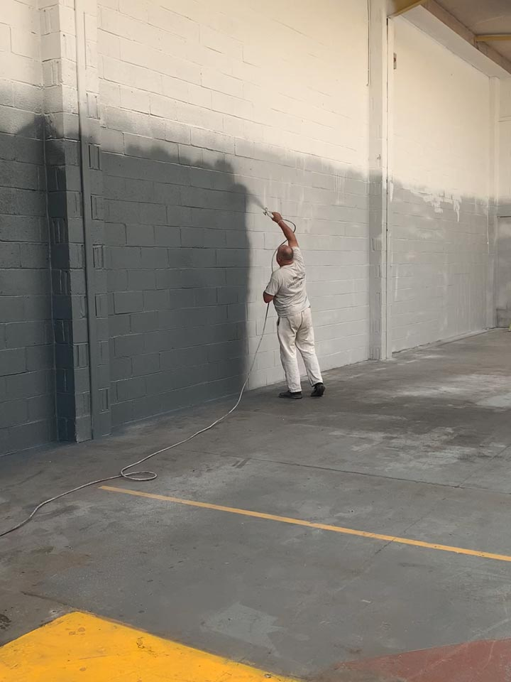 Paint Spraying the Interior Walls to an Industrial Warehouse Unit in Hamworthy - During Photo by Emerald Painters