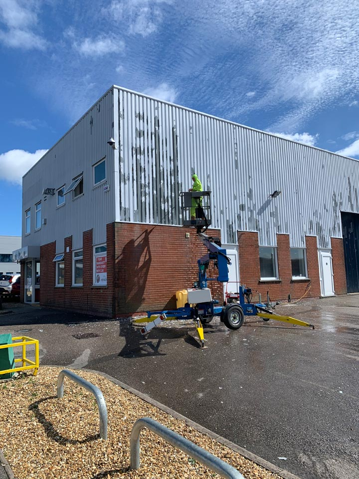 Washing Down and Preparing Hendy MG Car Showroom Exterior before Painting in Poole by Emerald Painters